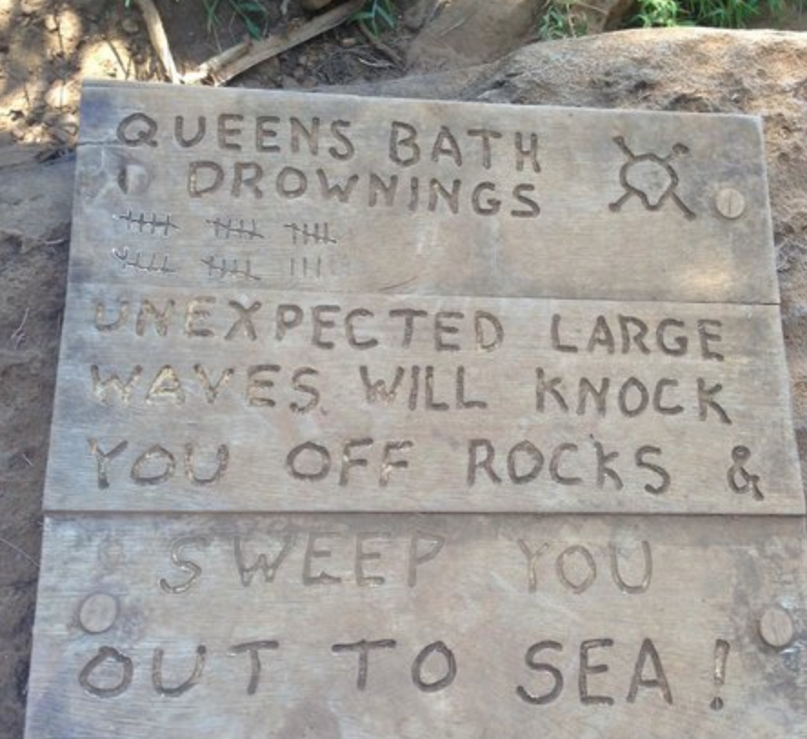 Queens Bath Warning Sign - what not to do in Hawaii